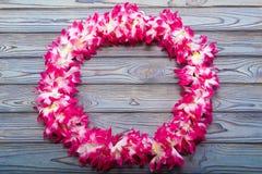Hawaiian wreath on a wooden background. Beach holidays, national holidays, recreational activities royalty free stock photography