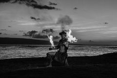 Hawaiin Dancer at the ocean. Black and white Image of a Hawaiian Dancer Royalty Free Stock Photography