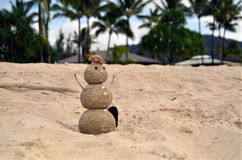Hawaiin Snowman. Snowman made of sand in Hawaii Royalty Free Stock Photos