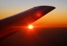 Hawaiin sunset. Plane flying over Hawaii at sunset Stock Photos