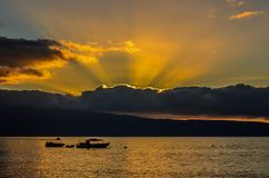 Hawaiin sunset. Fishing boats in a warm golden glow Stock Images