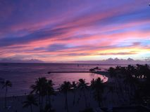 Hawaiin sunset honolulu. Purple pink blue and prange skies Stock Photography