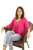 Hawaiin woman red shirt sit in chair Royalty Free Stock Photos