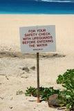 Hawajski zbawczy znak ostrzega pływaczki obrazy royalty free