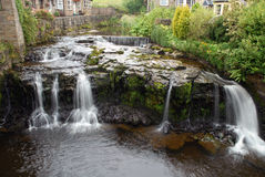 Hawes Waterfall in North Yorkshire. A waterfall flowing through the village of Hawes in North Yorkshire Stock Image