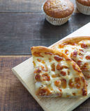 Hawii pizza and banana cupcake. On wood table Royalty Free Stock Photography