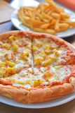 Hawiian pizza hot from oven Stock Images