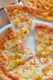 Hawiian pizza hot from oven Royalty Free Stock Image