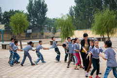 Hawk-and-chicken. Recess, teachers and students together to play games. This is a multiplayer puzzle game, name of this hawk-and-chicken. Baixiang County, Hebei Stock Photo
