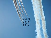 Hawk jet aircraft aerobatic team. Red Arrows over Polish sky. Hawk training aircraft in diamond formation making a loop during Radom Air show in Poland in 2010 Royalty Free Stock Image