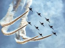 Hawk jet aircraft aerobatic team. Red Arrows over Polish sky. Hawk training aircraft formation during making a loop during Radom Air show in Poland in 2010 Royalty Free Stock Photography