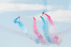 Hawk T1 jets with colored smokes on air show. Air show, Hawk T1 jets on air show performing with colored smokes Royalty Free Stock Photo