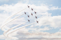 Hawk T1 jets with white smokes. Air show, Hawk T1 jets in arrow formation performing Stock Photography
