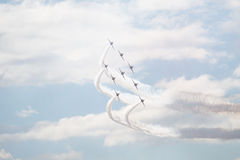 Hawk T1 jets with white smokes. Air show, Hawk T1 jets in arrow formation performing Royalty Free Stock Photo