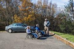 Hawk Watchers at Harvey's Knob Overlook. Bedford County, VA – November 3rd: Bird watchers at Harvey's Knob Overlook watching the hawks stock photography