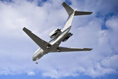 Hawker 4000 Horizon - Landing. Raytheon Hawker 4000 Horizon on final approach, passes over my head. View from behind royalty free stock image
