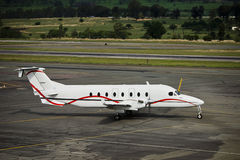 Hawker Beechcraft 1900D. The Beechcraft 1900 is a 19-passenger, pressurized twin-engine turboprop airplane manufactured by the Beechcraft Division of the royalty free stock photography