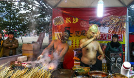 The hawker with a mask selling barbecue in lantern show, chengdu,china Stock Images