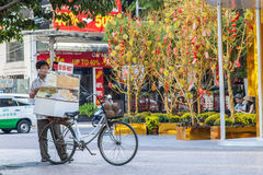 A hawker ( salesman ) is selling fast food at the downtown of Saigon ( Ho Chi Minh City ) Vietnam on Lunar New year Royalty Free Stock Photo