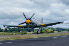 Hawker Sea Fury Take off. Hawker Sea Fury taking off for demonstration flight.  Equipped with the original Bristol Centaurus, set up for racing at the Reno Stock Photo