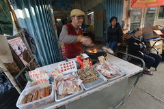 Hawker. Selling barbeque food at street stock photography