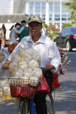 Hawker selling popcorn and candied fruit Royalty Free Stock Photos