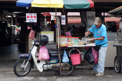 Hawker sells rojak on the road side in Penang, Malaysia Stock Images