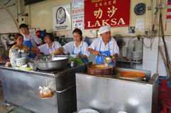 Hawker vendor at their Assam Laksa noodle stall in Air Itam, Pen Stock Photos
