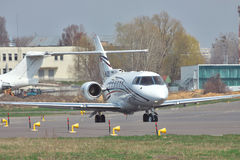 Hawker 850XP Business Jet. Kiev, Ukraine - April 14, 2012: Hawker 850XP business jet is taxiing to the runway for takeoff stock photos