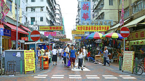 Hawkers at pei ho street market, sham shui po, hong kong. Pedestrians and hawkers selling bags, luggage and electronic items at pei ho street located at sham stock image