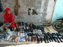 Hawkers. Selling slippers and shoes on the roadside in the village of Sukoharjo, Central Java, Indonesia royalty free stock photos