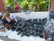 Hawkers. Selling slippers and shoes on the roadside in the village of Sukoharjo, Central Java, Indonesia stock photo