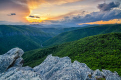 Hawkesbill Mountain, North Carolina. Summer sunset from Hawkesbill Mountain in North Carolina. This image is looking up Linville Gorge towards Linville Falls Stock Images