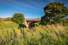 Hawkhill-Brücke über Fluss Aln Lizenzfreie Stockbilder