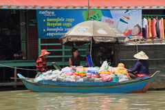Hawking With Boat. A Vietnamese women selling goods in a boat in Tonle Sap lake, Siem Reap, Cambodia royalty free stock image