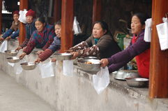 Hawking Food in Fenghuang. Women hawking food outside of Fenghuang Ancient Town in Hunan Province, China stock image