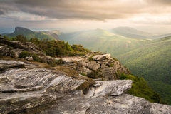 Hawksbill Sunset. Magnificent light on top of Hawksbill Mountain looking south in to the Linville gorge with Table Rock Mountain in the distance stock photo