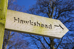 Hawkshead in the Lake District. A sign pointing towards the direction of Hawkshead in the Lake District in Cumbria, UK Royalty Free Stock Image