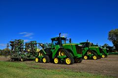 John Deere 9570 RX tractors with triangular tracks. HAWLEY, MINNESOTA, September 25, 2017: The 9570 RX tractors with triangular tracks and field cultivators are Royalty Free Stock Image