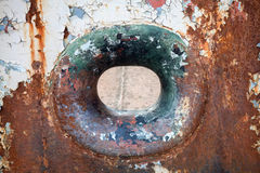 Hawse in old grungy rusted hull Stock Photos