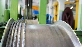 Hawser manufacturing. Steel hawser manufacturing process. Hawser on reel is visible closeup Stock Image