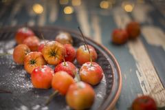 Hawthorn. Berries in the bowl on wood background Royalty Free Stock Photo