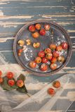 Hawthorn. Berries in the bowl on wood background Stock Photo