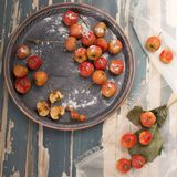 Hawthorn. Berries in the bowl on wood background Royalty Free Stock Photography