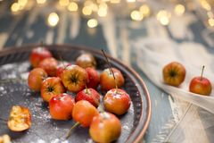 Hawthorn. Berries in the bowl on wood background Royalty Free Stock Photos