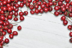 Hawthorn berries on wooden table Stock Photo
