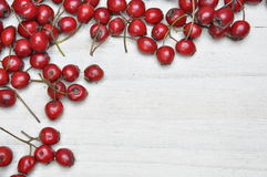 Hawthorn berries on wooden table Royalty Free Stock Photos