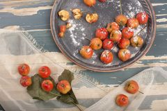 Hawthorn. Berries in the bowl on wood background Stock Photos