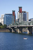 The Hawthorne bridge and a boat. Fishing near the Hawthorne bridge on the Willamette river Stock Photos