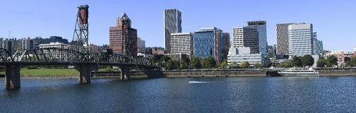Hawthorne Bridge and Skyline. The Hawthorne bridge on the East of the Portland Skyline and the Willamette river Stock Image